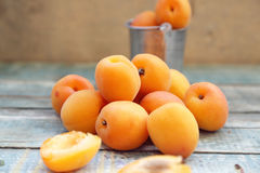 Apricot. Some fresh ripe raw juicy apricot on old wooden background Stock Photo