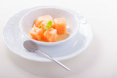 Apricot sorbet with mint. Served on the table Royalty Free Stock Photos