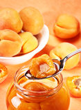 Apricot in spoon Stock Photos