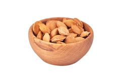Apricot stone in wooden bowl Royalty Free Stock Image