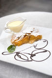 Apricot strudel with custard Stock Photos