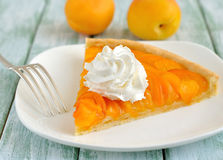 Apricot tart with whipped cream Royalty Free Stock Images