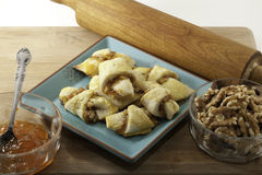 Apricot Walnut Rugelach. On a plate with walnuts and preserves Royalty Free Stock Photos