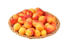 Apricot in wattled plate Royalty Free Stock Image