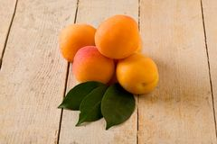 Apricot on wooden table Stock Photos
