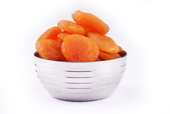 Apricots. Dried apricots in a bowl - isolated Royalty Free Stock Photos