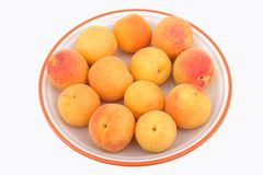 Apricots. On a plate Royalty Free Stock Images