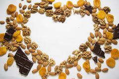 Apricots, almonds and walnut with copy space in a shape of heart Stock Photo