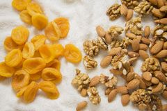 Apricots, almonds and walnuts on white Stock Photo