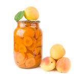 Apricots and apricot jam. Stock Photos