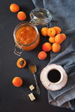 Apricots, apricot jam and cup of coffee Stock Image