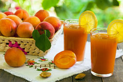 Apricots. Apricot smoothies with fresh apricots royalty free stock photography