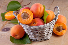 Apricots in Basket on Wooden Background Stock Photo