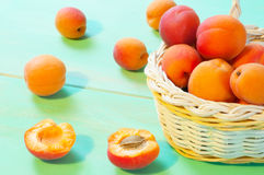Apricots in basket on wooden background Stock Images