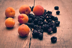Apricots and blackberries Stock Photos
