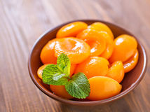 Apricots. In the brown bowl stock photos