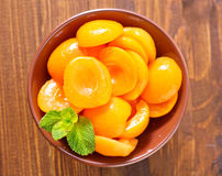 Apricots. In the brown bowl royalty free stock photo