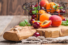 Apricots and cherries on rustic  background Stock Photos