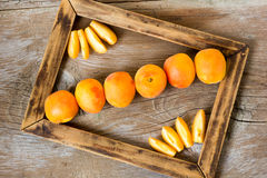 Apricots. Fresh apricots, on wooden background Royalty Free Stock Photo