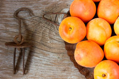 Apricots. Fresh apricots, on wooden background Stock Photos