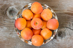 Apricots. Fresh apricots, on wooden background Royalty Free Stock Images