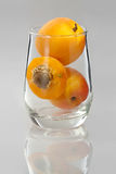 Apricots in a glass. Beautiful tasty apricots in a transparent glass Royalty Free Stock Image