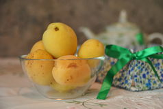 Apricots in a glass cup. Still life: apricots in a glass cup  on the kitchen table Stock Photos