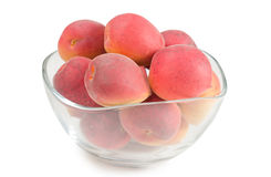 Apricots in a glass dish. On a white background Royalty Free Stock Images