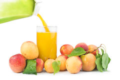 Apricots and glass juice. Stock Photo