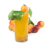 Apricots and glass juice. Royalty Free Stock Images