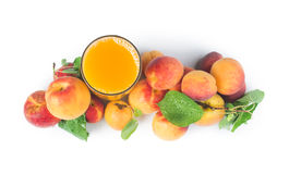 Apricots and glass juice. Royalty Free Stock Photos