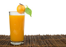 Apricots and glass juice. Stock Images