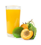 Apricots and glass juice. Royalty Free Stock Photo