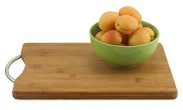 Apricots in green bowl stock image