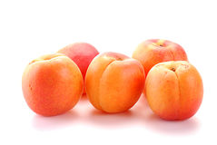Apricots isolated on white. Background Stock Photos