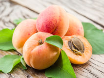 Apricots and its cross-section. Royalty Free Stock Images