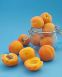 Apricots and the jar Royalty Free Stock Photo