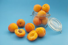 Apricots and the jar Stock Photography