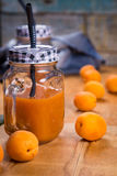Apricots with juice. Some fresh ripe raw apricots with juice on wooden background Stock Photography