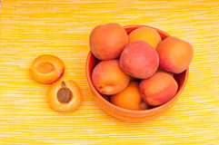 Apricots with kernel on a yellow tablecloth Royalty Free Stock Photos