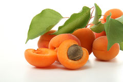 Apricots with leafs isolated Royalty Free Stock Photography