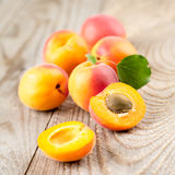 Apricots with leaves. On the old wooden table stock photography