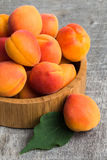 Apricots with leaves on  old wooden table Stock Photography