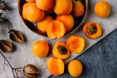 Apricots in a metal pial are stacked stock photos