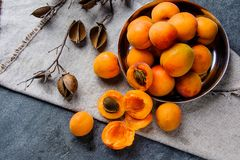 Apricots in a metal pial are stacked stock images