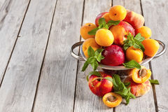 Apricots, nectarines and saturn peaches background Stock Image