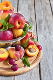 Apricots, nectarines and saturn peaches background Stock Images