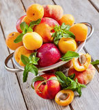 Apricots, nectarines and saturn peaches Royalty Free Stock Images
