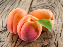 Apricots on a old wooden table. Royalty Free Stock Photo