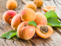 Apricots on the old wooden table. Royalty Free Stock Photography